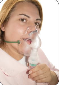 Photograph shows patient wearing an oxygen mask.