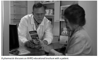 A pharmacist discusses an AHRQ educational brochure with a patient.